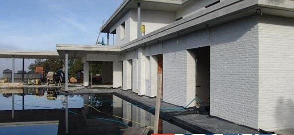 Colocación de impermeabilizante en una cubierta plana